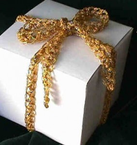 Knitted Ribbon in chained metallic gold yarn