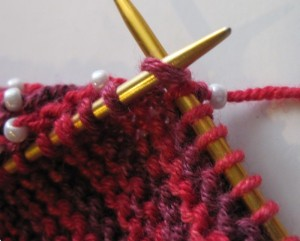 Beads do not show on wrong side of beaded garter stitch