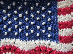 Bead stars in the miniature knitted representation of the U.S. flag