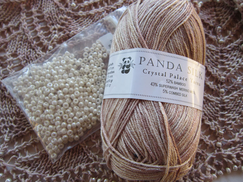 Crystal Palace Panda Silk yarn and Miyuki beads to make Swags of Lace Crescent Scarf