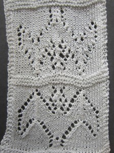 Barbara Walker's lace bat - as per original instructions on bottom; knitted with rows in reverse order on top