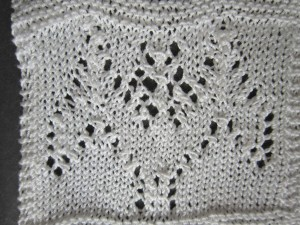 Upside down lace bat made from just knitting the rows in reverse order