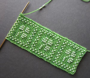 knit a strip of fabric which is later joined into a tube