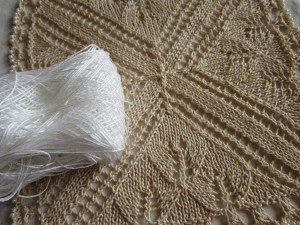 comparison of white thread to after being dyed with tea