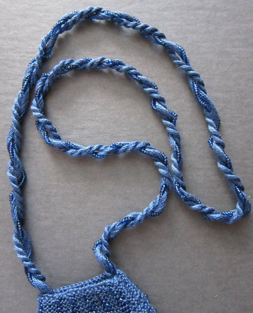 Twisted cord with beaded strand added