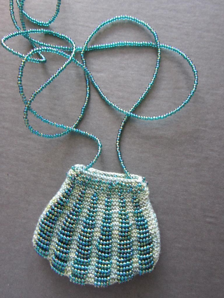 Beaded bag with necklace cord of strung beads